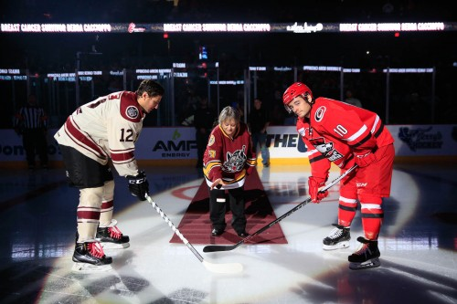 Debra Caccioppo, who is now cancer free, drops the ceremonial puck on Breast Cancer Awareness Day at Allstate Arena prior to the Chicago Wolves matchup against Charlotte. Photo: Ross Dettman/Chicago Wolves