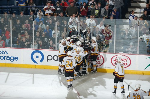 Hockey hugs for all. The celebration grows as the Wolves pile out onto the ice to give Andre Benoit some love following his game-winner against Rockford on Saturday at Allstate Arena. Photo: Steve Woltmann/Chicago Wolves
