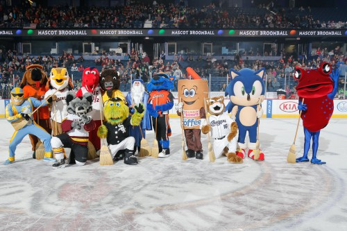 Everyone smile! Or whatever it is you mascots do. The whole gang gathered for a group picture on the ice following the surprisingly intense broomball game on Mascot Day at Allstate Arena. Photo: Ross Dettman/Chicago Wolves