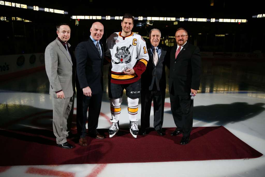 Chicago Wolves captain Pat Cannone is honored with the Dan Snyder Man of the Year Award for his charitable work throughout the Chicago-area community. Photo: Ross Dettman/Chicago Wolves